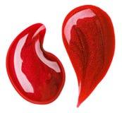 Le vernis à ongles rouge (émail) relâche l'échantillon Photographie stock