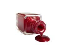 Le vernis à ongles rouge découle de la bouteille Photo libre de droits