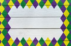Le vert de diamant, modèle pourpre et jaune a peint le fond de vacances de Mardi Gras L'espace vide pour la copie, texte, marquan photo libre de droits