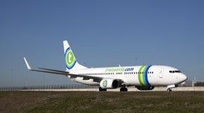 Le vert est la couleur de cette avion de ligne Images stock