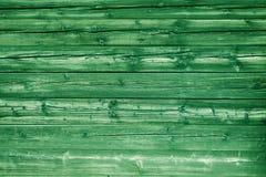 Le vert naturel a coloré des panneaux en bois de pin comme fond Photographie stock