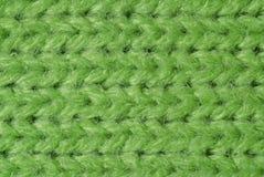 Le vert a tricoté des laines étroitement vers le haut Photographie stock libre de droits
