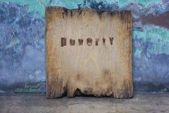 Le vieux conseil en bois aiment un symbole de la pauvreté Photographie stock libre de droits
