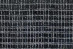 Le vieux haut-parleur sale noir troue la texture, poussiéreuse Photo stock