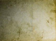 Le vieux jaune souillé et le papier brun donnent au calibre une consistance rugueuse vide de fond Photographie stock
