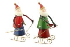 Le vieux métal Santa Claus de vintage figure sur un traîneau Images stock