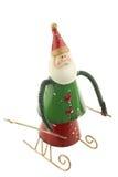 Le vieux métal Santa Claus de vintage figure sur un traîneau Photo libre de droits