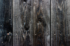 Le vieux noir a peint le mur en bois - texture ou fond Images stock