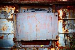 Le vieux piloté dans l'hublot Photographie stock libre de droits