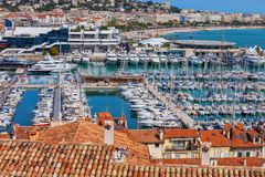 Le Vieux Port in Cannes City on French Riviera. France, Cannes, resort city on French Riviera, yachts and sailboats at Le Vieux Port on Mediterranean Sea stock photos
