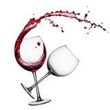Le vin rouge avec éclabousse Photographie stock