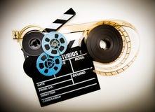 Le vintage de bobines de panneau et de film de clapet colorent l'effet Photographie stock