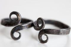 Le vintage fait main de fer sonne avec le symbole d'infini - foyer sélectif/profondeur du champ Photos libres de droits