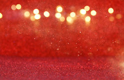 Le vintage rouge de scintillement allume le fond image stock