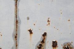 Le vintage s'est rouillé grunge de texture peint sur le mur gris Photos libres de droits