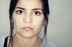 Le visage de jeune femme Photo stock