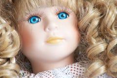 Le visage de la poupée de porcelaine Photographie stock libre de droits