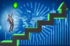 Le vol d'homme d'affaires sur le ballon chaud au-dessus du graphique Image stock