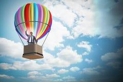 Le vol d'homme d'affaires sur le ballon dans le concept de défi Images stock