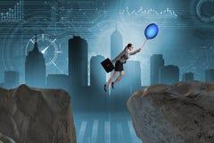 Le vol de femme d'affaires tenant le ballon Images libres de droits