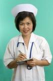 le writing för sjuksköterska Royaltyfria Bilder