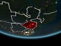Le Zimbabwe sur terre de l'espace la nuit Photographie stock libre de droits