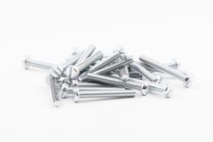 Le zinc argenté de plan rapproché a enduit l'isolat de vis sur le fond blanc Photo stock
