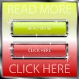 Lea más y haga clic aquí los botones en una superficie reflexiva del color Fotos de archivo libres de regalías