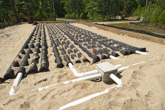 Leaching field. New leaching field being installed on a new home construction site Royalty Free Stock Images