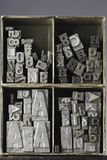 Lead. Letters typeset in a box Royalty Free Stock Photo