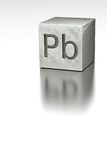 Lead cube with Plumbum mark Stock Photos