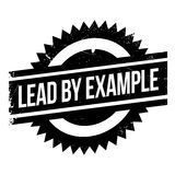 Lead by example stamp Stock Photo