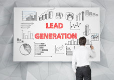 Lead generation concept with sketches. Lead generation concept with businessman drawing business sketches on whiteboard Stock Image