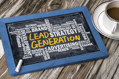 Lead generation handwritten on blackboard with related words clo Stock Images