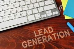 Lead generation. Lead generation written on a wooden surface stock photo