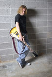 The Lead Guitar Player. The lead guitarist of a rock band poses for the camera Stock Photography