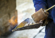Lead melting torch to repair windows Royalty Free Stock Images