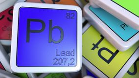 Lead Pb block on the pile of periodic table of the chemical elements blocks. 3D rendering Royalty Free Stock Images