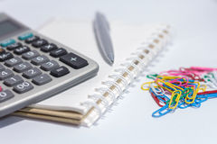 Lead pen and Calculator on book Stock Image