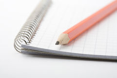 Lead pencil on notepad. Stock Photos
