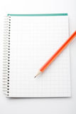 Lead pencil on notepad. Royalty Free Stock Images