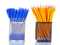 Lead pencils and pens in metal cups Stock Photos