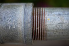 Lead pipe. Close up of a lead pipe Royalty Free Stock Photos