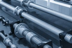 The lead screw spare  part of CNC machine. In the light blue scene Stock Images