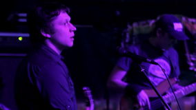 Lead singer performs on stage stock video footage