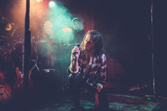 Lead singer on stage Royalty Free Stock Images