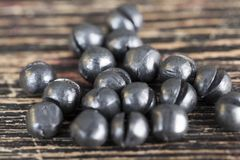 Lead sinker for fishing. Rods during fishing, close-up of round sinkers on a black board stock photo