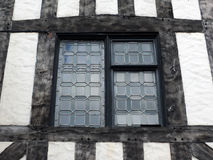 Leaded glass window in a half timbered house Stock Photography