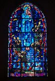 Leaded windows in a church in Sainte Mere Eglise with paratrooper. John Steele who landend on the church and hang there playing dead for hours during d-day in Stock Images