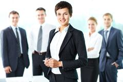Leaded by woman. Pretty lady being a successful businesswoman at the head of a strong team Stock Images